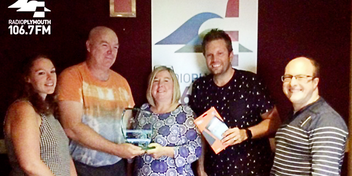 Photo of John McBride, second from the left, receiving the Radio Plymouth Carer of the Year Award in June 2017.
